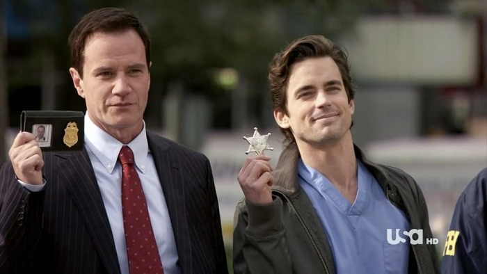Matt Bomer as Neal Caffrey in White Collar accompanied by his FBI handler Peter Burke